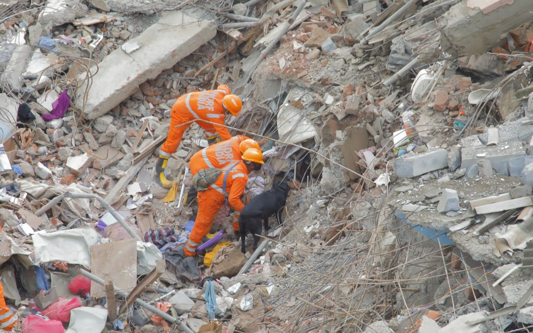 IN PHOTOS: Child Rescued 22 Hours After Deadly Building Collapse