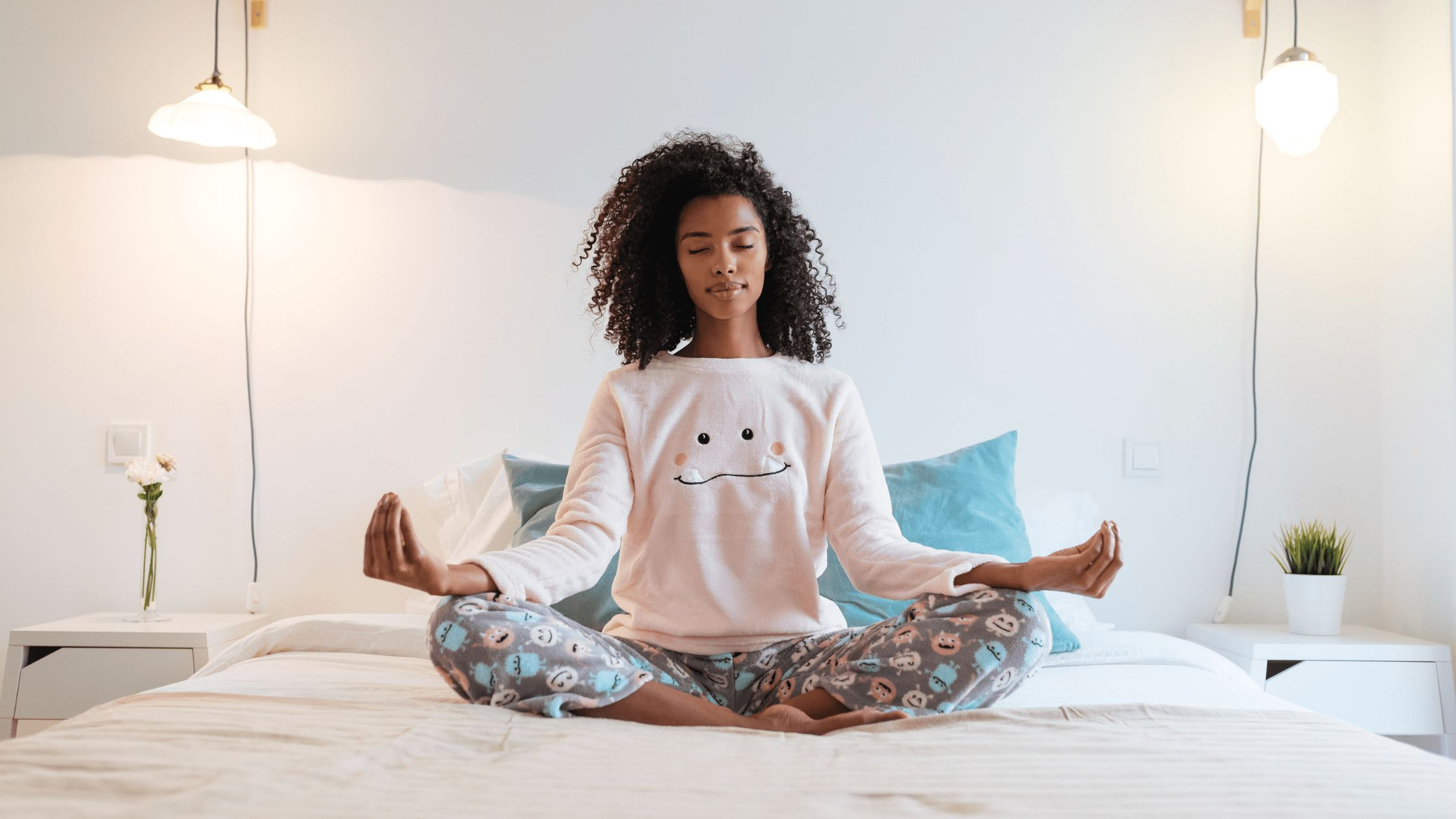 girl meditating on bed
