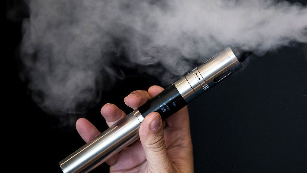 A Vape Lab employee uses an e-cigarette on Aug. 27, 2014, in London, England. Aerosols produced by e-cigarettes impair the function of blood vessels, according to a recent study by the American Heart Association. (Dan Kitwood/Getty Images)