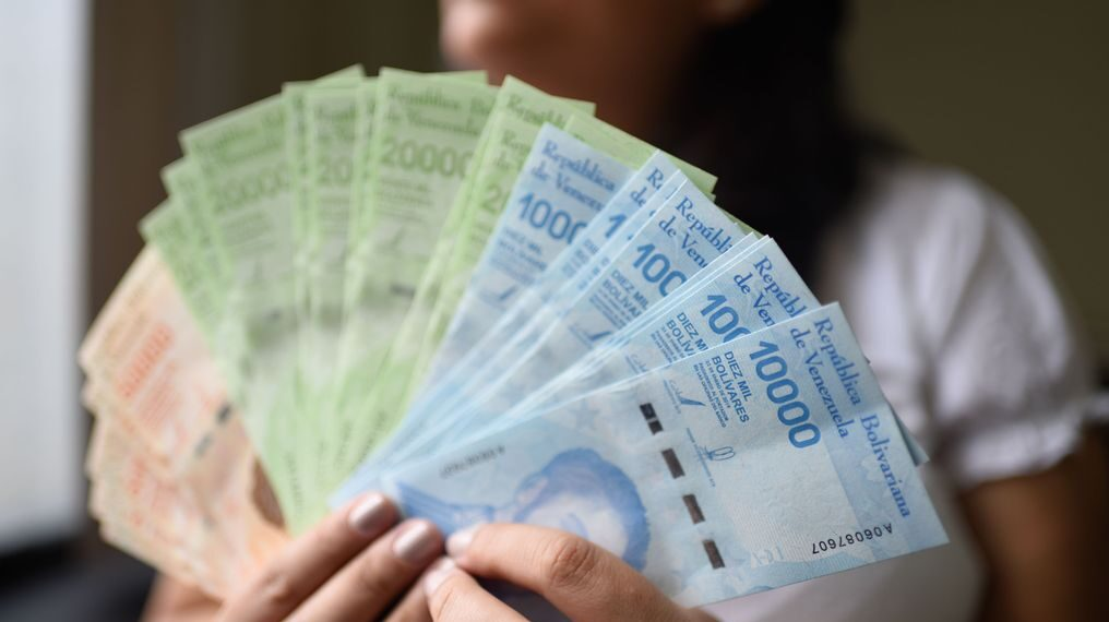 Venezuela has removed zeros from its bills in response to hyperinflation. The picture shows 2019 bills, with several zeros. (Carolina Cabral / Getty Images)